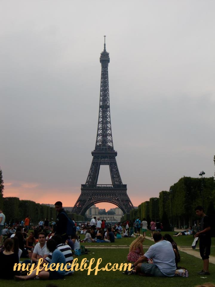 La tour Eiffel on a summery evening.  Picnic time on the Champs de Mars.Sunset